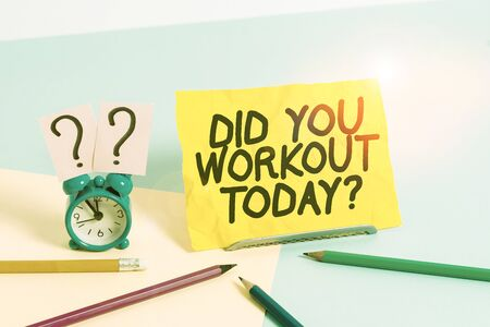Foto de Text sign showing Did You Workout Today. Business photo text asking if made session physical exercise Mini size alarm clock beside stationary placed tilted on pastel backdrop - Imagen libre de derechos