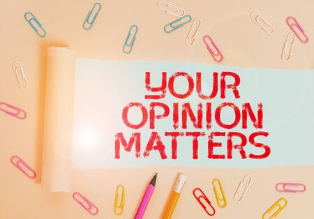 Foto de Writing note showing Your Opinion Matters. Business concept for to Have your say Providing a Valuable Input to Improve Stationary and torn cardboard placed above plain pastel table backdrop - Imagen libre de derechos