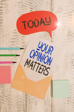 Writing note showing Your Opinion Matters. Business concept for to Have your say Providing a Valuable Input to Improve Envelop speech bubble paper sheet ballpoints notepads wooden background