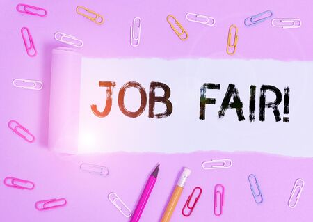 Writing note showing Job Fair. Business concept for event where employers offer information about their companies Stationary and torn cardboard on a wooden classic table backdrop