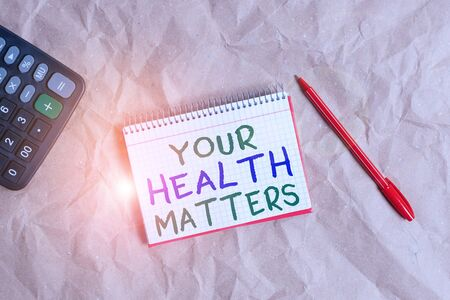 Foto de Word writing text Your Health Matters. Business photo showcasing Physical Wellness is Important Stay Fit and Healthy Papercraft craft paper desk square spiral notebook office study supplies - Imagen libre de derechos