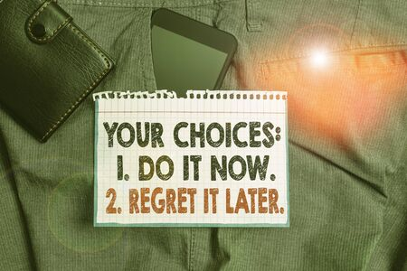Photo for Writing note showing Your Choices 1 Do It Now 2 Regret It Later. Business concept for Think first before deciding Smartphone device inside trousers front pocket with wallet - Royalty Free Image