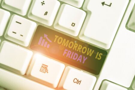 Photo pour Writing note showing Tomorrow Is Friday. Business concept for Weekend Happy holiday taking rest Vacation New week White pc keyboard with note paper above the white background - image libre de droit