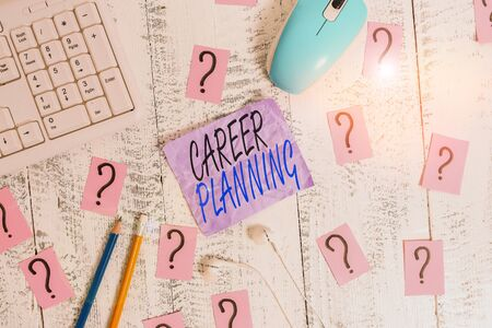 Writing note showing Career Planning. Business concept for Strategically plan your career goals and work success Writing tools and scribbled paper on top of the wooden table