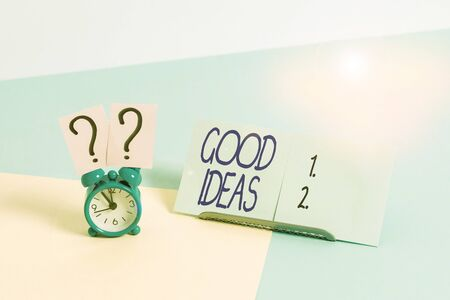 Photo pour Writing note showing Good Ideas. Business concept for nice formulated thought or opinion Best possible course of action Alarm clock beside a Paper sheet placed on pastel backdrop - image libre de droit