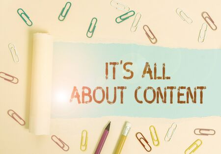 Writing note showing It S All About Content. Business concept for Express thru Writing Information and Experience Stationary and torn cardboard placed above plain pastel table backdrop