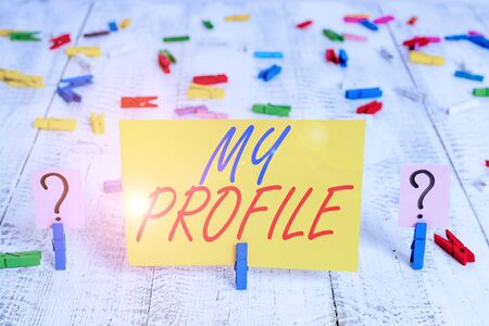Writing note showing My Profile. Business concept for record of your demonstratingal information that defines who you are Crumbling sheet with paper clips placed on the wooden table