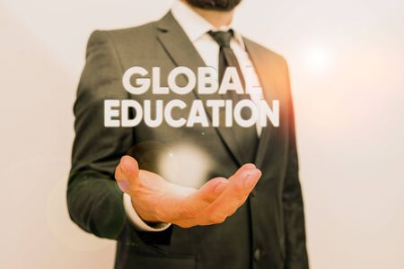 Photo pour Conceptual hand writing showing Global Education. Concept meaning ideas taught to enhance one s is perception of the world Male human with beard wear formal working suit clothes hand - image libre de droit