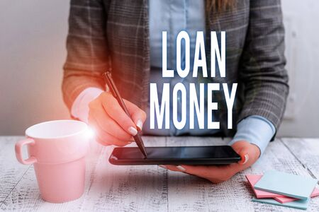 Photo for Writing note showing Loan Money. Business concept for Something lent or furnished on condition being returned Business woman sitting with mobile phone and cup of coffee on the table - Royalty Free Image