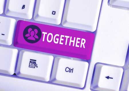 Handwriting text Together. Conceptual photo In proximity,union or collison with another demonstrating or things White pc keyboard with empty note paper above white background key copy space