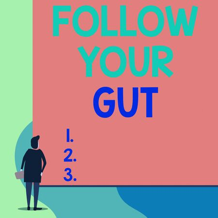 Photo pour Writing note showing Follow Your Gut. Business concept for Listen to intuition feelings emotions conscious perception Back view young woman watching blank big rectangle - image libre de droit
