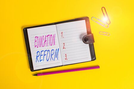 Photo pour Conceptual hand writing showing Education Reform. Concept meaning planned changes in the way a school system functions Dark leather locked diary striped sheets marker colored background - image libre de droit