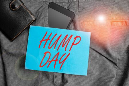 Photo for Conceptual hand writing showing Hump Day. Concept meaning climbing a proverbial hill to get through a tough week Wednesday Smartphone device inside trousers front pocket with wallet - Royalty Free Image