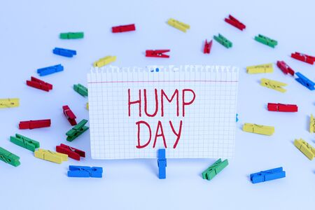 Photo for Writing note showing Hump Day. Business concept for climbing a proverbial hill to get through a tough week Wednesday Colored clothespin papers empty reminder white floor background office - Royalty Free Image