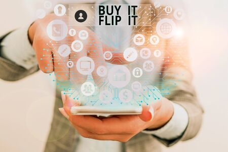 Writing note showing Buy It Flip It. Business concept for Buy something fix them up then sell them for more profit