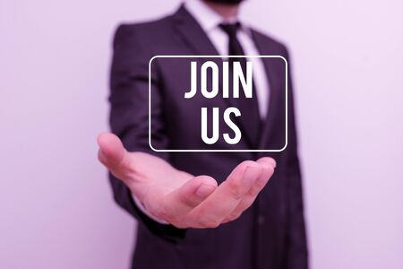 Photo for Writing note showing Join Us. Business concept for Register in community Team or blog Sign up at social media Male human with beard wear formal working suit clothes hand - Royalty Free Image