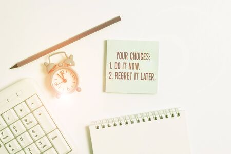 Photo for Handwriting text writing Your Choices 1 Do It Now 2 Regret It Later. Conceptual photo Think first before deciding White pc keyboard with empty note paper and pencil above white background - Royalty Free Image
