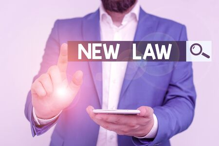 Word writing text New Law. Business photo showcasing system of rules that enforced through social or governmental Businessman in the blue suite with lap top pointing with finger