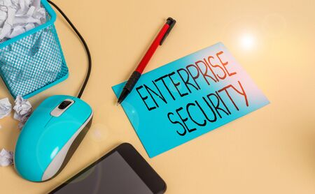 Conceptual hand writing showing Enterprise Security. Concept meaning decreasing the risk of unauthorized access to data crumpled paper in bin placed next to modern gadget and stationary