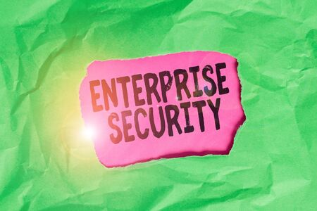 Word writing text Enterprise Security. Business photo showcasing decreasing the risk of unauthorized access to data Green crumpled ripped colored paper sheet centre torn colorful background