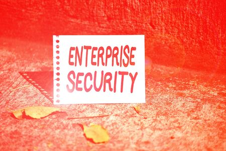 Handwriting text Enterprise Security. Conceptual photo decreasing the risk of unauthorized access to data Empty Spiral Bound Notebook Sheet Torn Off Folded in Half Dried Leaves