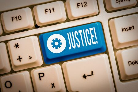 Text sign showing Justice. Business photo showcasing impartial adjustment of conflicting claims or assignments White pc keyboard with empty note paper above white background key copy space