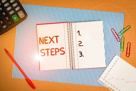 Photo pour Text sign showing Next Steps. Business photo text something you do or plan after you ve finished something else Striped paperboard notebook cardboard office study supplies chart paper - image libre de droit