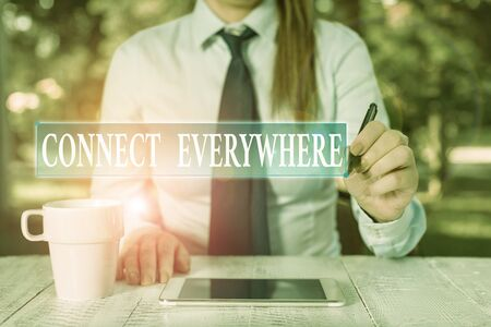 Photo for Conceptual hand writing showing Connect Everywhere. Concept meaning channel of communication available anywhere and anytime Female business person sitting and holding mobile phone - Royalty Free Image