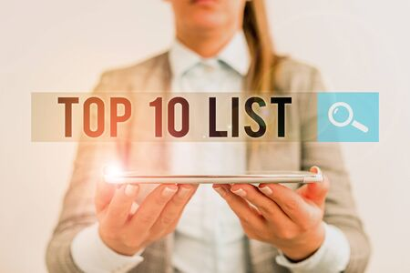 Photo pour Handwriting text Top 10 List. Conceptual photo the ten most important or successful items in a particular list Business concept with mobile phone and business woman - image libre de droit