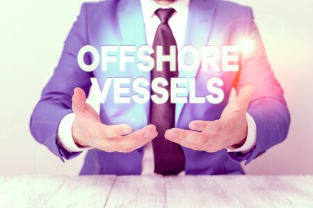 Photo pour Conceptual hand writing showing Offshore Vessels. Concept meaning ship designed to supply offshore oil and gas platforms Man holds empty paper with copy space in front of him Space - image libre de droit