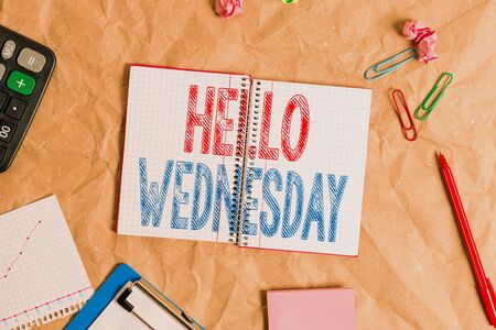 Photo for Handwriting text Hello Wednesday. Conceptual photo Hump day Middle of the working week of the calendar Papercraft craft paper desk square spiral notebook office study supplies - Royalty Free Image