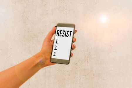 Handwriting text Resist. Conceptual photo To fight against something or someone that is attacking you