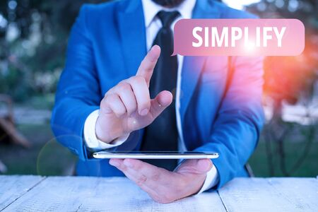 Photo pour Writing note showing Simplify. Business concept for make something simpler or easier to do or understand unravel Businessman with pointing finger in front of him - image libre de droit