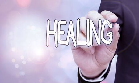 Photo for Text sign showing Healing. Business photo showcasing process of making or becoming sound or healthy again Helping injured - Royalty Free Image