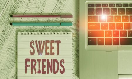 Photo pour Writing note showing Sweet Friends. Business concept for thoughtful towards other showing Nice and loving demonstrating Metallic laptop blank ruled notepad pens lying old wooden vintage table - image libre de droit