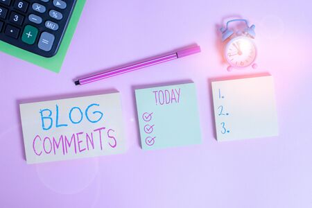 Handwriting text writing Blog Comments. Conceptual photo Space at the end of each post for a reader to leave a comment Multicolor notepads alarm clock calculator sheet marker colored background