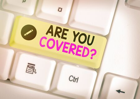 Foto de Text sign showing Are You Covered Question. Business photo text asking showing if they had insurance in work or life - Imagen libre de derechos