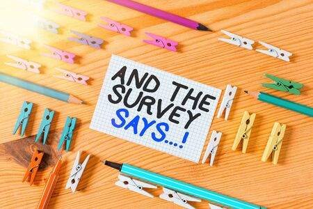 Photo pour Conceptual hand writing showing And The Survey Says. Concept meaning written spoken results of short quiz or exam on internet Colored crumpled papers wooden floor background clothespin - image libre de droit