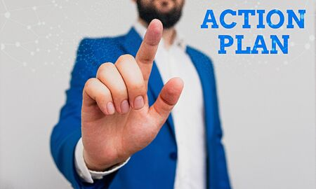Photo for Writing note showing Action Plan. Business concept for detailed plan outlining actions needed to reach goals or vision Businessman with pointing finger in front of him - Royalty Free Image