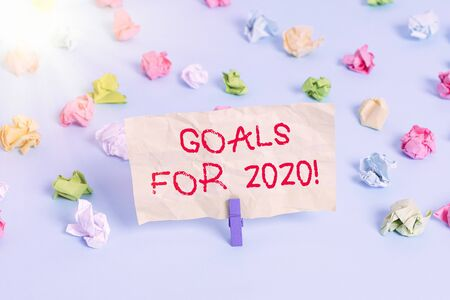 Photo pour Word writing text Goals For 2020. Business photo showcasing object of demonstratings ambition or effort aim or desired result Colored crumpled papers empty reminder blue floor background clothespin - image libre de droit