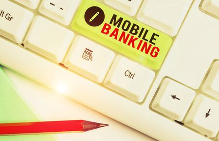 Writing note showing Mobile Banking. Business concept for use of cellular device to perform online banking tasks