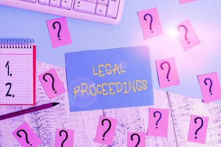 Word writing text Legal Proceedings. Business photo showcasing procedure instituted in a court of law to acquire benefit Writing tools, computer stuff and math book sheet on top of wooden table