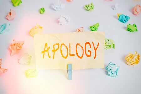 Photo for Text sign showing Apology. Business photo showcasing a written or spoken expression of one s is regret remorse or sorrow Colored crumpled papers empty reminder white floor background clothespin - Royalty Free Image