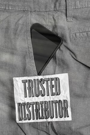 Text sign showing Trusted Distributor. Business photo text Authorized Supplier Credible Wholesale Representative Smartphone device inside formal work trousers front pocket near note paper