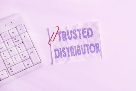 Writing note showing Trusted Distributor. Business concept for Authorized Supplier Credible Wholesale Representative White pc keyboard with empty note paper above white background