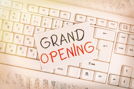 Foto de Writing note showing Grand Opening. Business concept for Ribbon Cutting New Business First Official Day Launching Keyboard office supplies rectangle shape paper reminder wood - Imagen libre de derechos