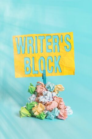 Handwriting text Writer S Block. Conceptual photo Condition of being unable to think of what to write Reminder pile colored crumpled paper clothespin reminder blue background