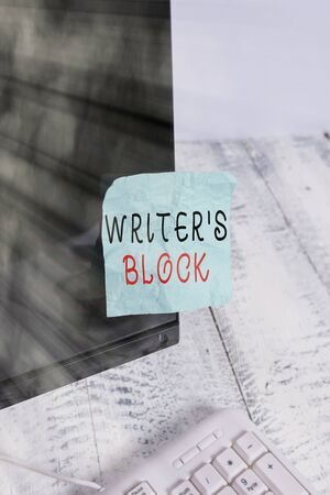 Text sign showing Writer S Block. Business photo text Condition of being unable to think of what to write Notation paper taped to black computer monitor screen near white keyboard