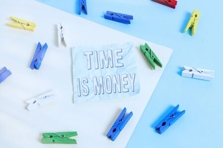 Handwriting text Time Is Money. Conceptual photo time is a valuable resource Do things as quickly as possible Colored clothespin paper empty reminder yellow blue floor background office