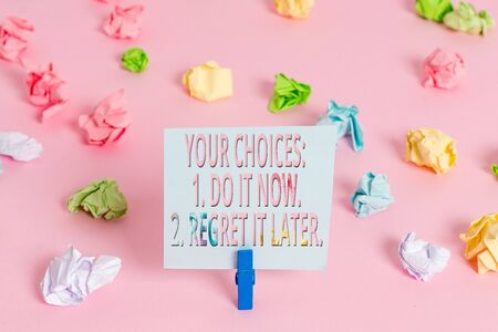 Photo for Word writing text Your Choices 1 Do It Now 2 Regret It Later. Business photo showcasing Think first before deciding Colored crumpled papers empty reminder pink floor background clothespin - Royalty Free Image